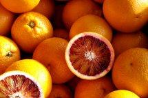 halved blood orange an top of blood oranges