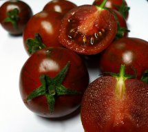 chocolate tomatoes on white background