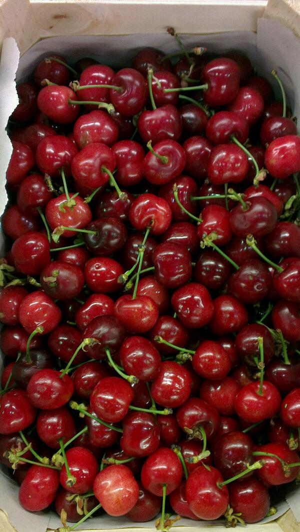 cherries in a wooden crate