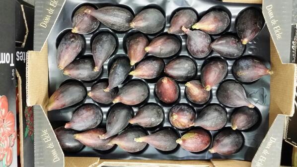 black figs in cardboard box