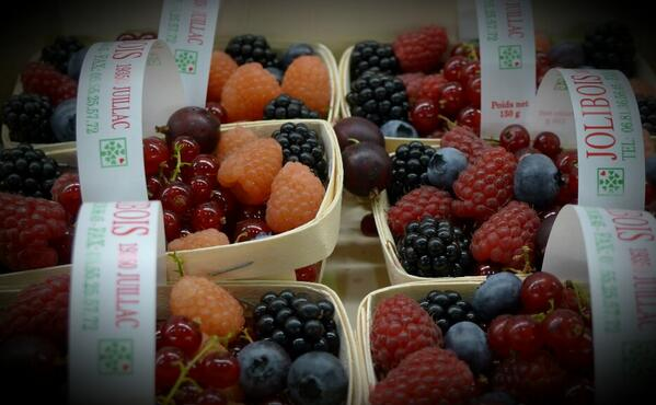 mixed fresh berries in wooden punnets