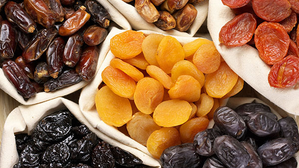Assorted dried fruits in bags, dates, apricots, prunes