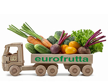Bouquet of ripe vegetables in trailer, toy made of wood. White background, studio shot, close-up.